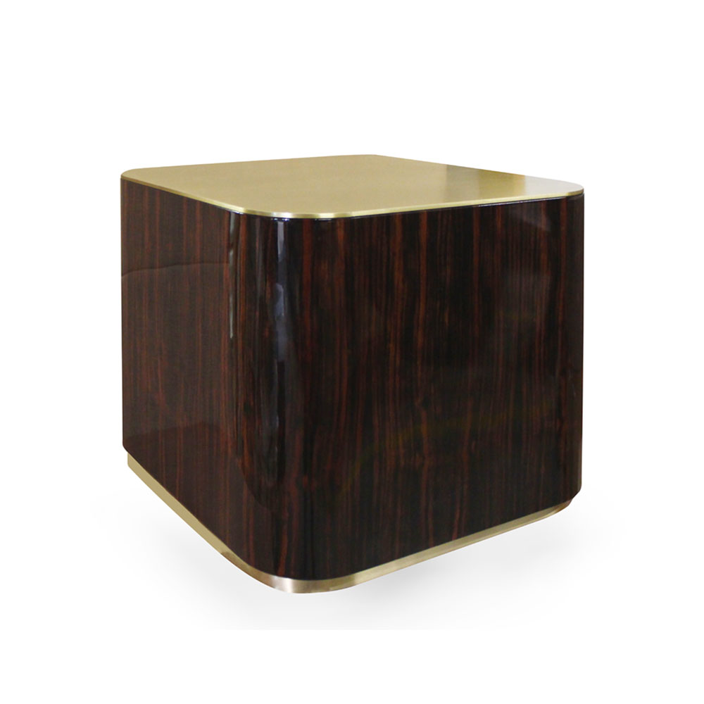 Cube with rounded corners in high-gloss Macassar ebony with brass top and narrow base