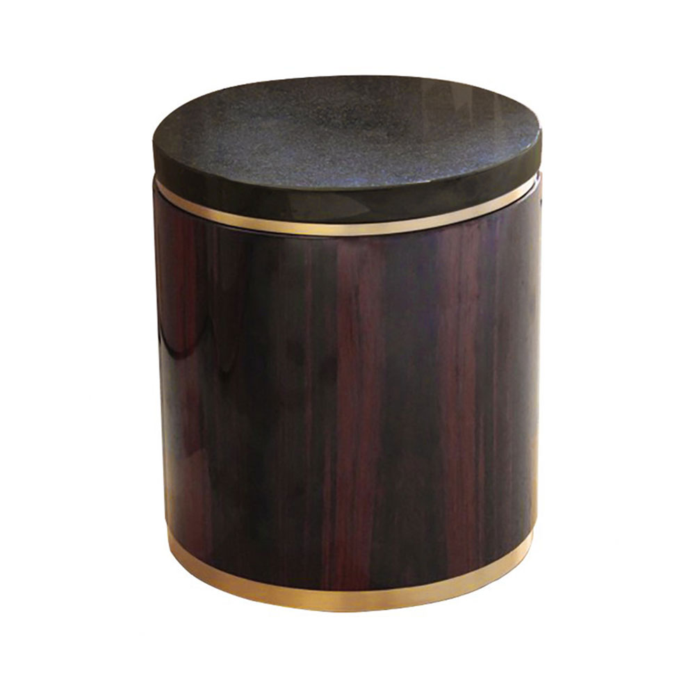Round side table with cylinder base in Macassar ebony with brass border and base and black granite top.