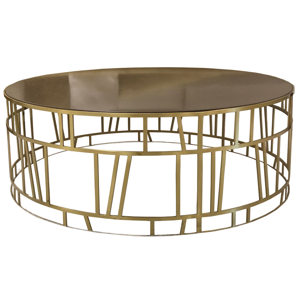 Round metal coffee table with open brass cage design and granite top