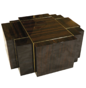 coffee table of fitted rectangular blocks in high-gloas Macassar ebony with brass angled view