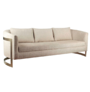 Curved sofa with brass legs