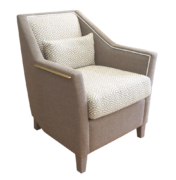 traditional lounge chair with metal detail and upholstered legs