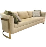 modern curved sofa with brass legs