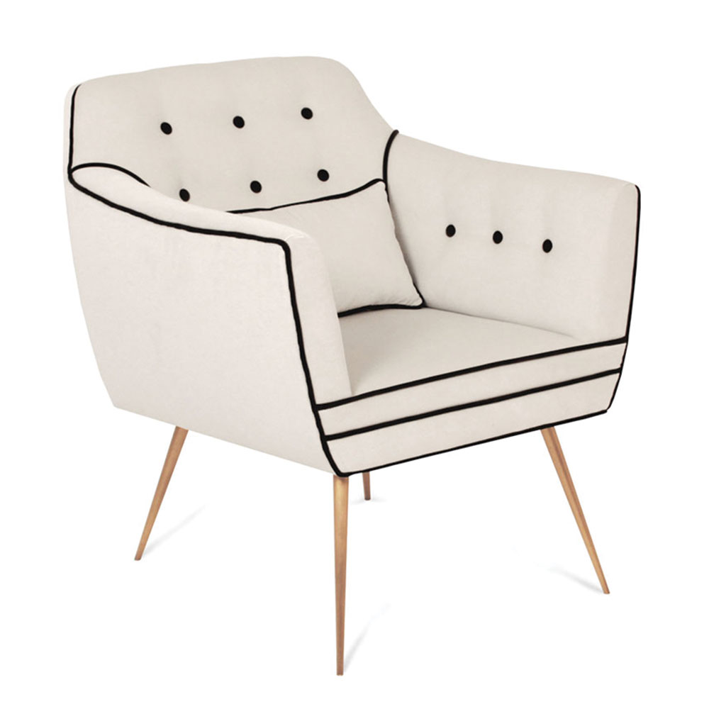 modern tufted armchair with thin brass legs