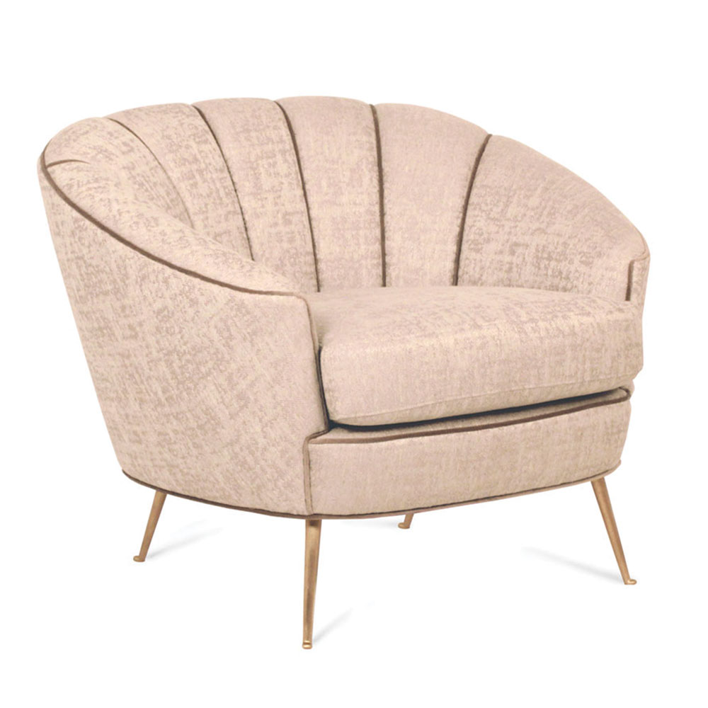 modern armchair with scalloped back and thin brass legs