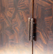 Detail of bronze pull hardware and close up of Macassar parquetry