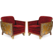 Red velvet lounge chairs with gold relief side panels and ivory lacquer carved feet