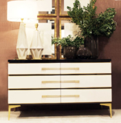 Gubon chest with brass hardware in room view