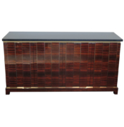 Sideboard in high-gloss Macassar ebony with dimensional design with brass details and dark granite top