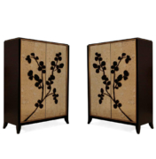 Pair of wood and gold glass cabinets with relief branch design
