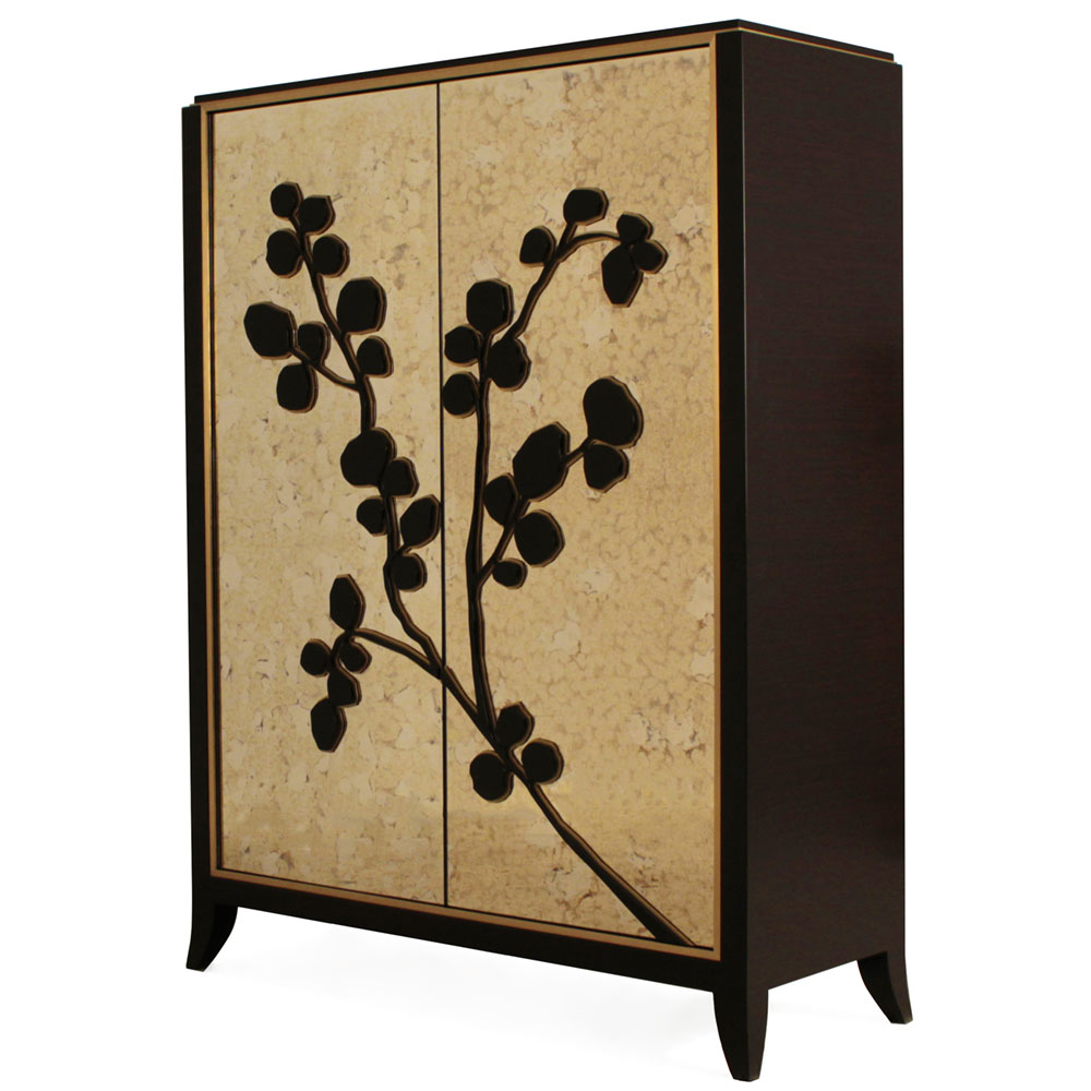 Gold leaf and ebony wood cabinet with stylized branch design