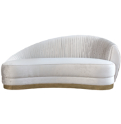 Curved kidney sofa lounge with asymmetrical pleated back