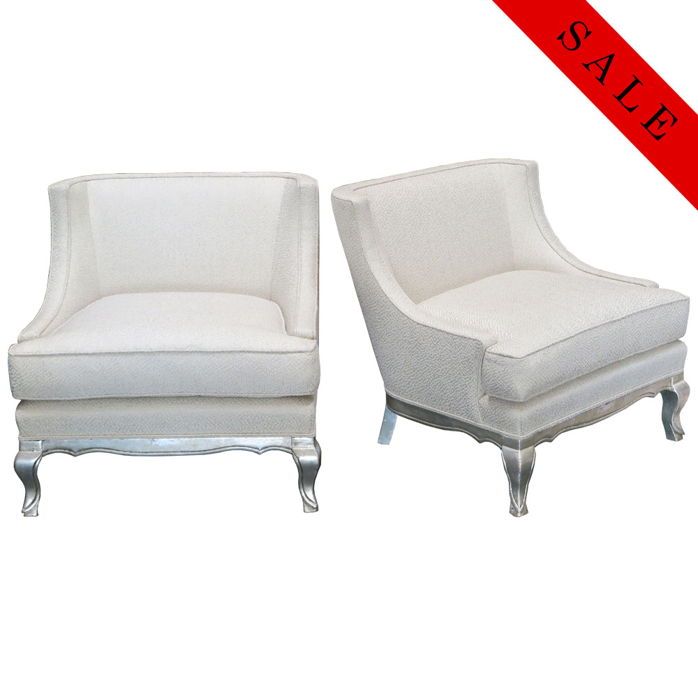 Vintage pair of white chairs with silver leaf feet