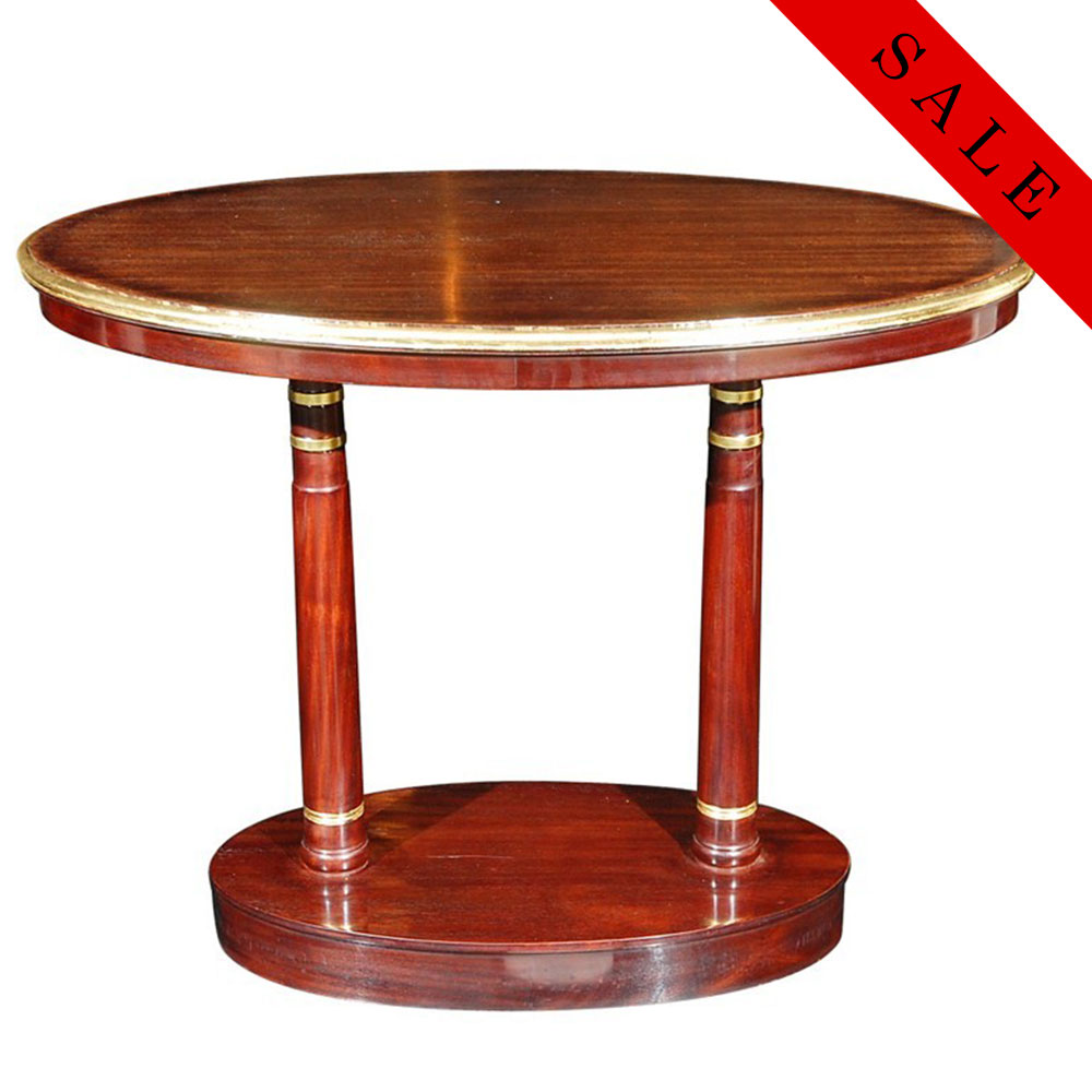 Double pedestal oval Empire side table in Mahogany with gold leaf