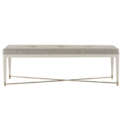 clean lined modern upholstered bench with brass metal crossbar