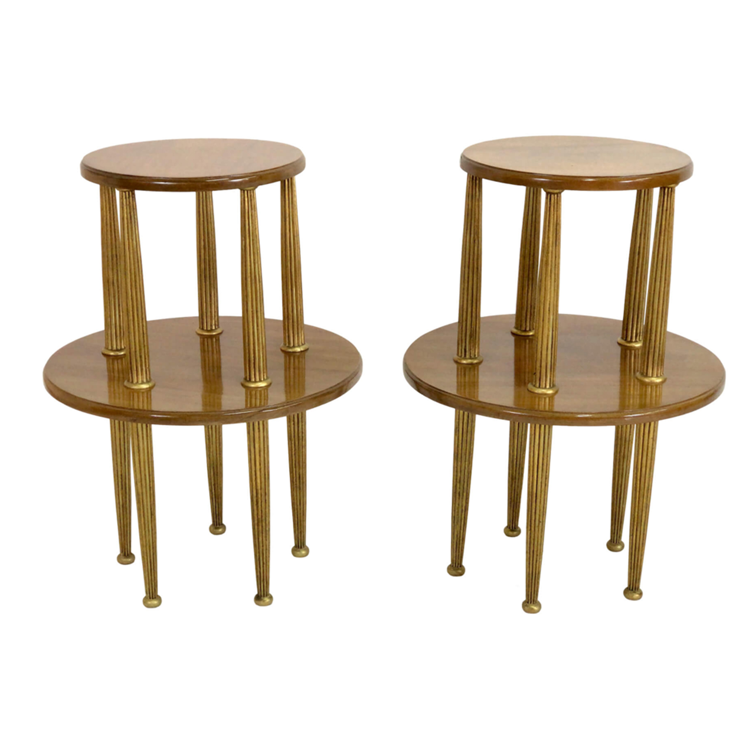 A set of Art Deco side tables in light brown mahogany wood with gold fluted legs.