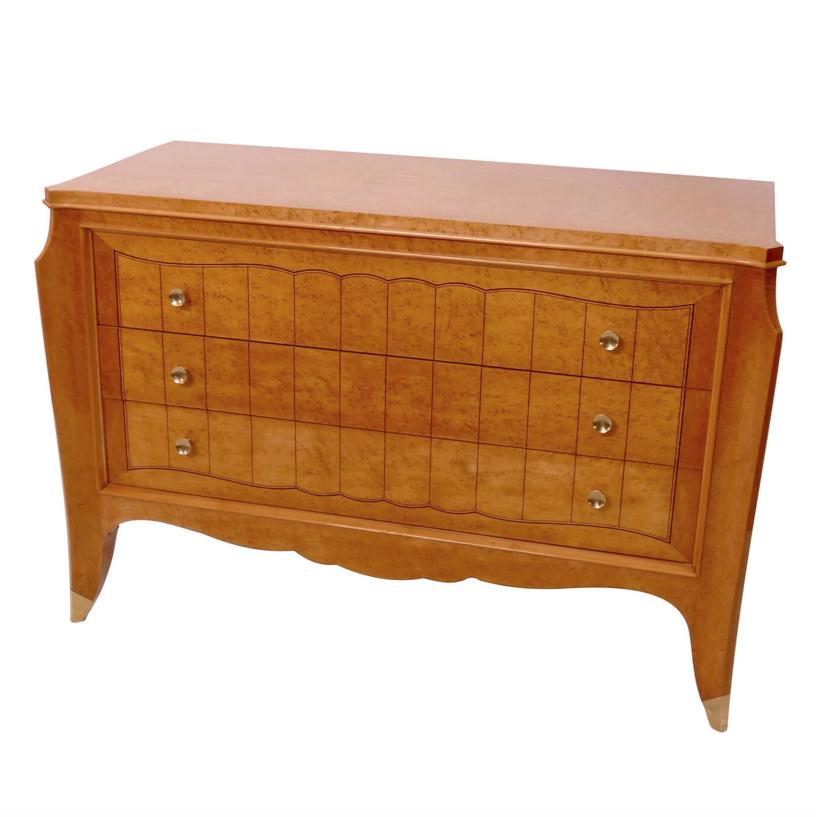 Bird's Eye Maple wood dresser in light brown with brass details.