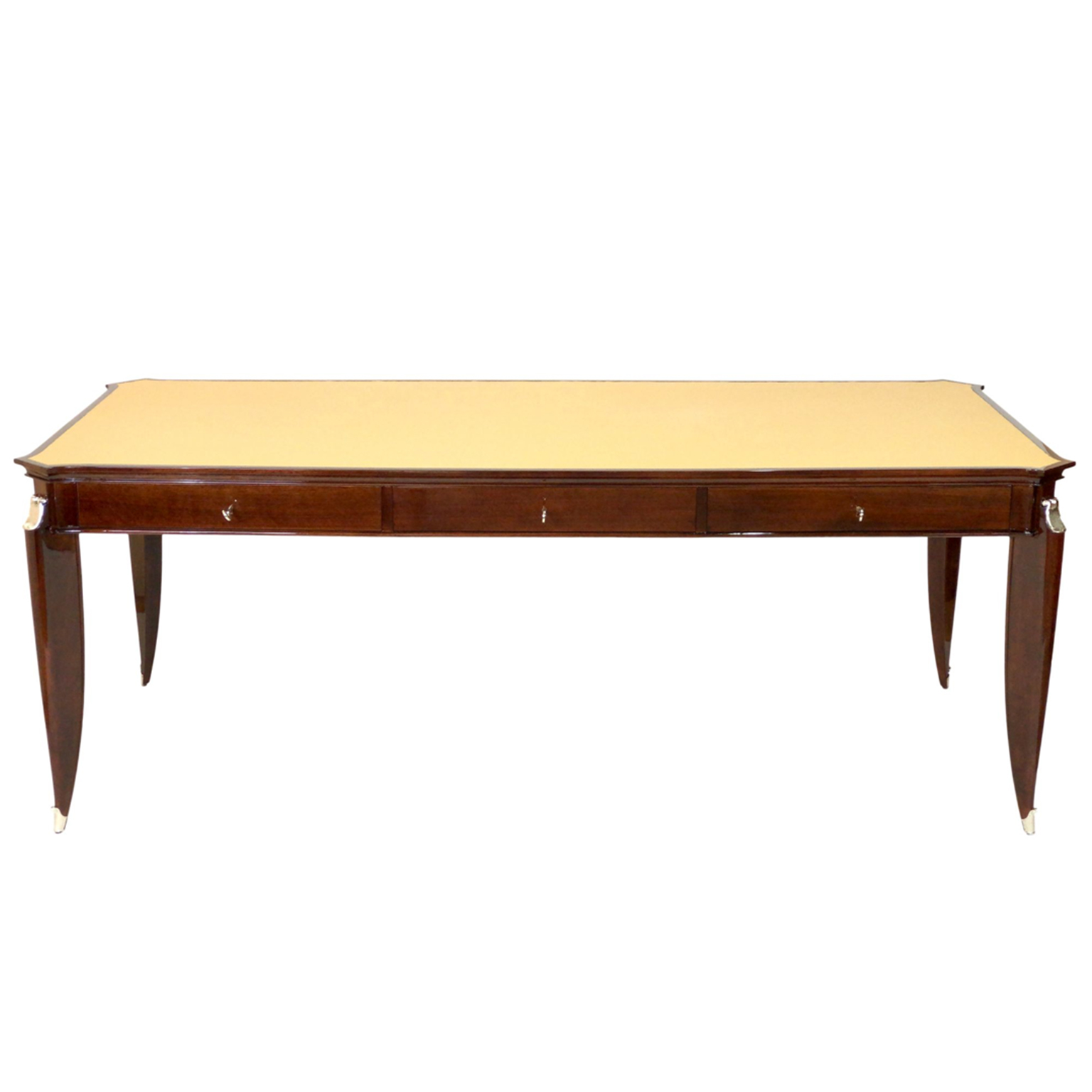 Art Deco desk designed by Jean Pascaud in brown mahogany wood and light leather top with nickel hardware and foot caps.