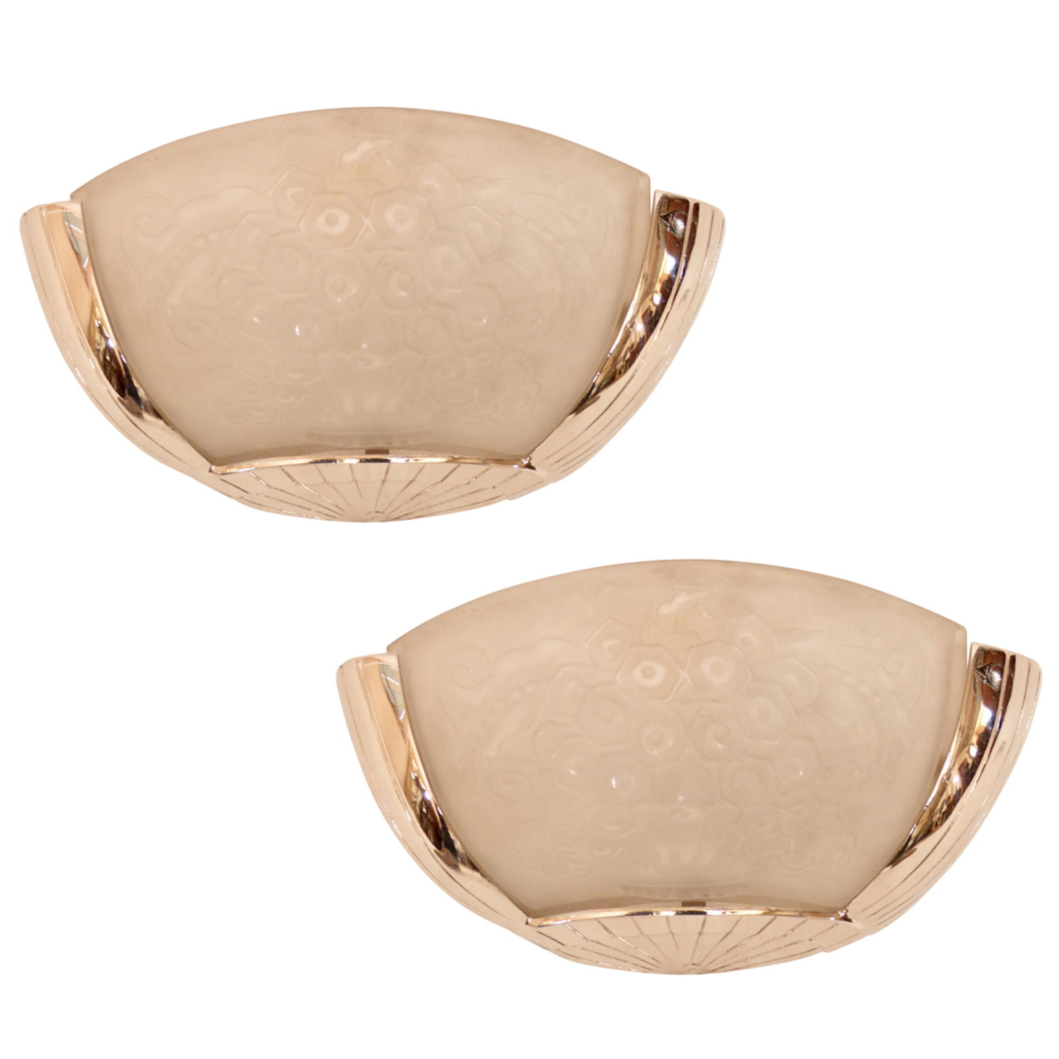 Sconces with frosted glass and brass hardware.